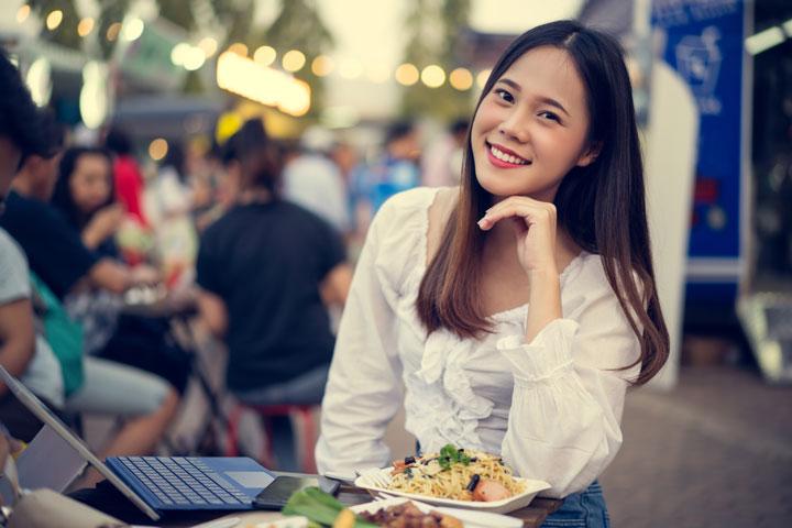 asian Korean woman eating street-food
